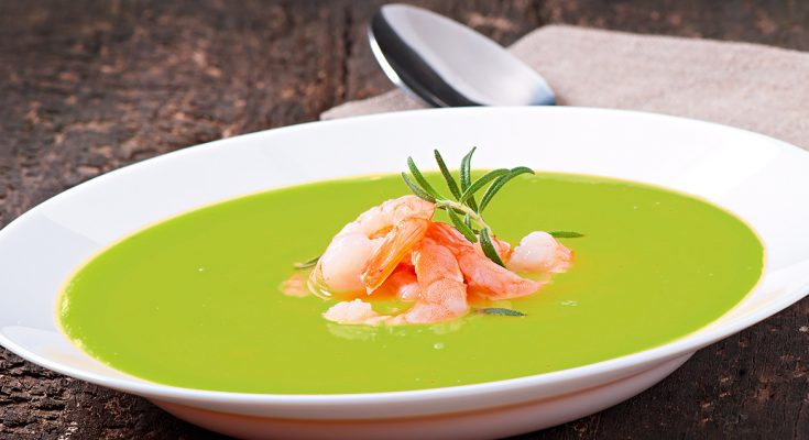 Zucchini cream soup with shrimps.